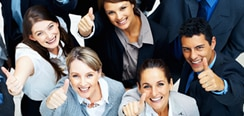 a group of people in business attire with hands raised