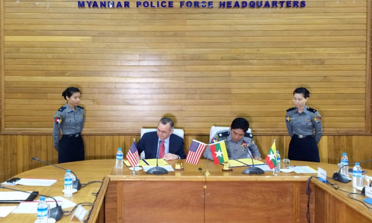Ambassador Scot Marciel and Acting Police Chief Police Brigadier General Aung Win Oo signed an agreement